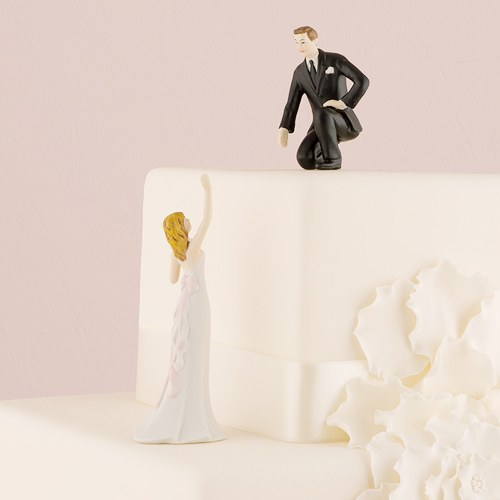 reaching bride and helpful groom mix match cake toppers