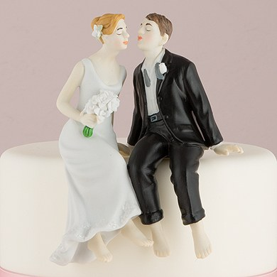 and groom sitting on edge of the cake romantic wedding cake topper